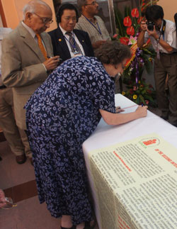 Jeanne Mirer signs Call at Second Intl Conf in Hanoi, 8/2011